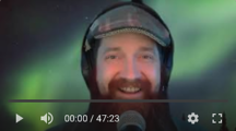 Andy Neely's bearded, smiling, headphone-wearing face.